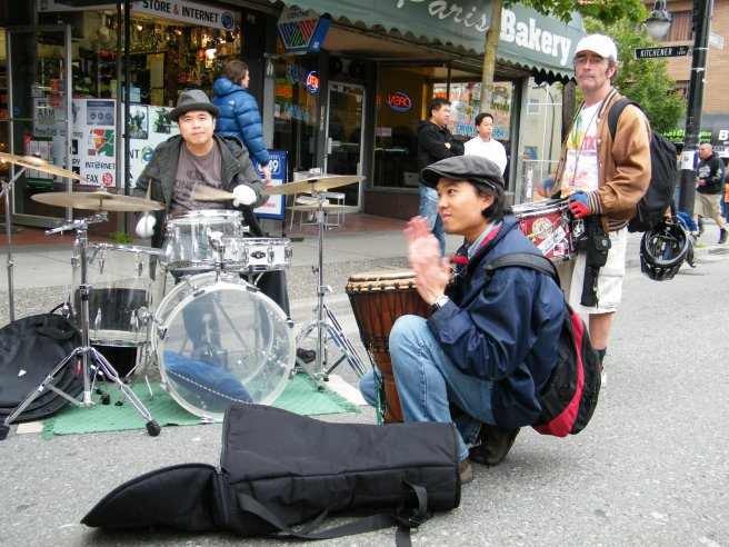 A band sets up in the street.
