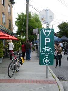 A valet bike parking sign.