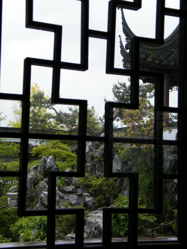 Through a window onto the garden.