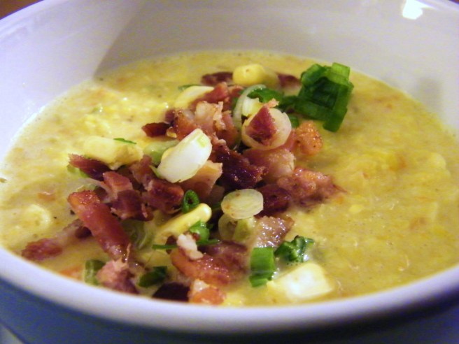 The finished soup, with a garnish of green onion, bacon, corn kernels and a little cayenne.