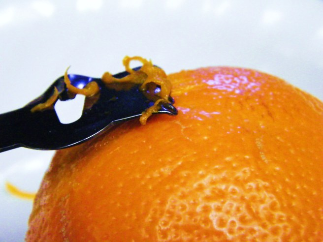 Zesting an orange.