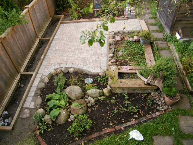 Completed patio, with new raised beds on the side.