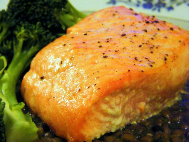 Roasted salmon atop french lentils, with a little broccoli on the side.