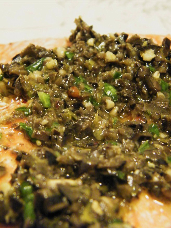 "Tapenade ""sauce"" over salmon."