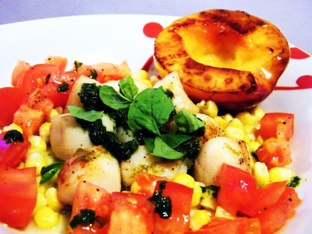 Warm scallop salad with nectarines, corn, tomatoes, basil coulis, and lime dressing.