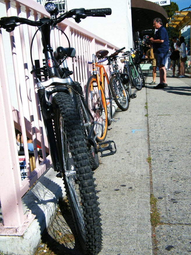 Bikes locked to the railing at the Waldorf Hotel.