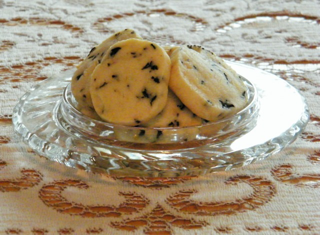 Olive Sablés in a crystal dish atop a vintage lace tablecloth
