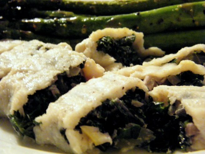 Sole stuffed with kale and quick-preserved lemons, with roasted asparagus in the background.