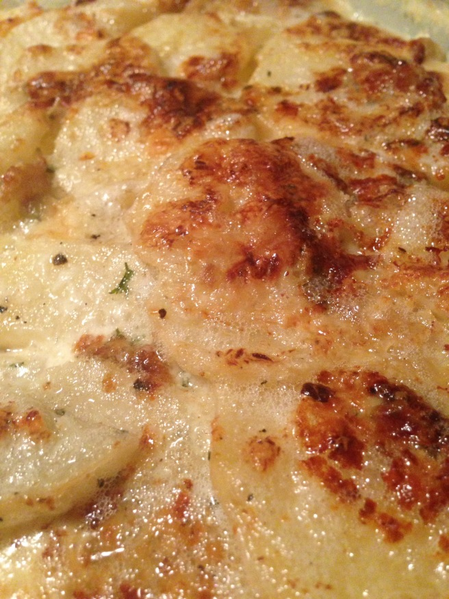Scalloped potatoes with blue cheese and roasted garlic