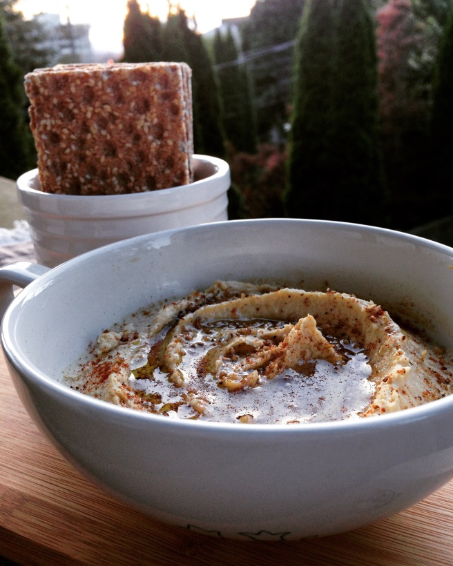 Hummus garnished with dukkah, smoked paprika, and olive oil