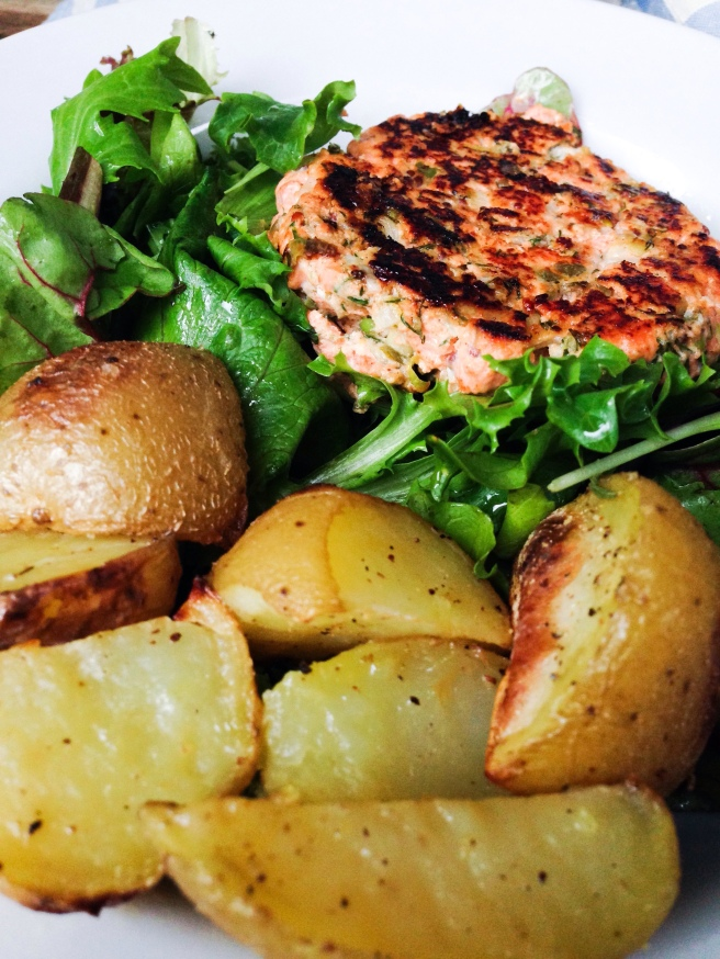 Salmon burgers over greens with oven-roasted potatoes.